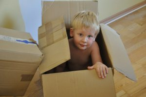 a cheerful child in a box